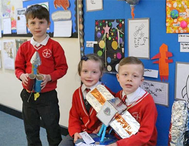 Children displaying items they have made